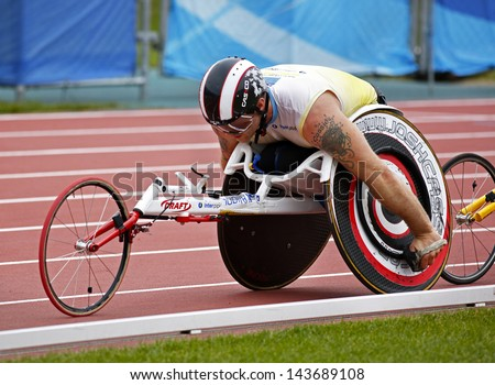 MONCTON, CANADA - June 22: 10,000-meter run wheelchair athlete Joshua Cassidy races at the Canadian Track & Field Championships June 22, 2013 in Moncton, Canada. - stock photo