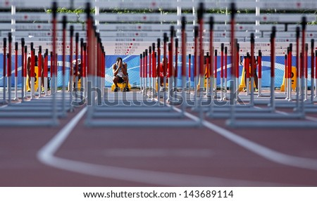 MONCTON, CANADA - June 22: Moseley Ingvar prepares for the 110-meter hurdles at the Canadian Track & Field Championships June 22, 2013 in Moncton, Canada. - stock photo