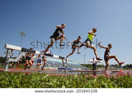 MONCTON, CANADA - June 28: Steeplechasers Chris Winter (top), Christopher Dulhanty, Matthew Hughes (9) and Taylor Milne (3) at Canadian Track & Field Championships June 28, 2014 in Moncton, Canada. - stock photo