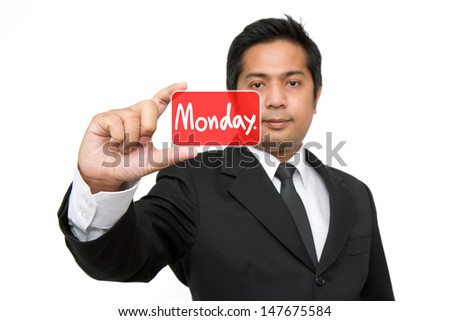 Monday Business man holding monday  button