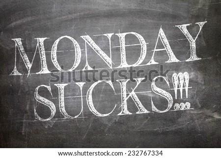 Monday Sucks written on blackboard - stock photo