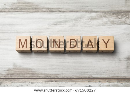 monday word on wooden background