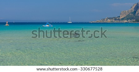 MONDELLO, SICILY, ITALY - MAY 26: people bathing and relaxing in the sea in Mondello on May 26, 2011.