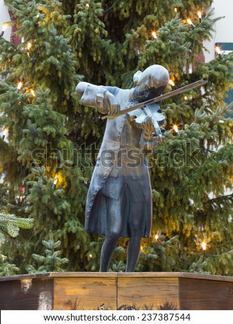 Mondsee - December 4, 2014 - Mozart sculpture and Christmas tree in the suburbs of December 4, 2014 Mondsee, Mondsee, Austria - stock photo