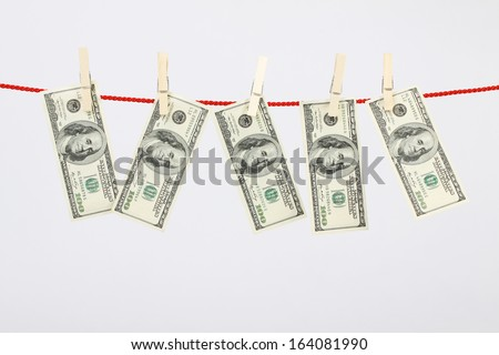 Money american hundred dollar bills hanging on laundry line - horizontal  - stock photo