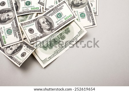 money american hundred dollar bills - horizontal on grey background
