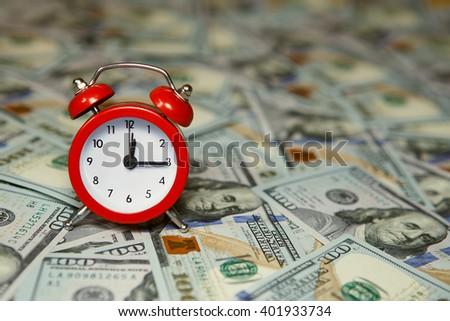 Money american hundred dollar bills. time is money concept. Time is money, clocks under american dollars - stock photo