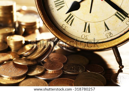 Money and alarm clock, closeup