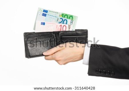 Money and business topic: hand in a black suit holding a wallet with banknotes 10,20 and 100 euro on white isolated background in studio