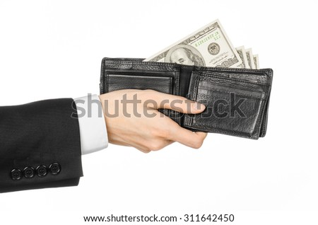 Money and business topic: hand in a black suit holding a wallet with dollar banknotes isolated on white background in studio - stock photo