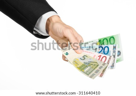 Money and business topic: hand in a black suit holding banknotes 5,10,20 and 100 euro on white isolated background in studio - stock photo
