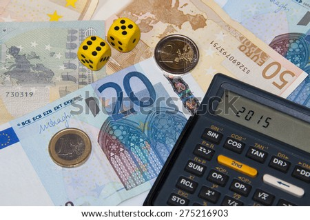 Money and calculator and dice  in year 2015