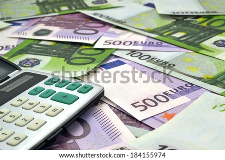 Money and calculator/ Image of calculator with money 100 and 500 euro