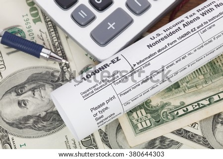 Money and calculator With Tax form.