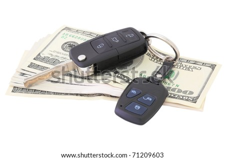 money and car keys on a white background isolated - stock photo