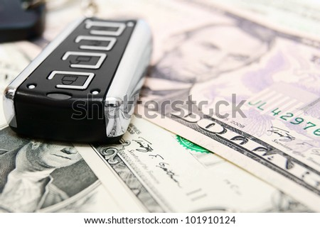 Money and charm from the car. - stock photo