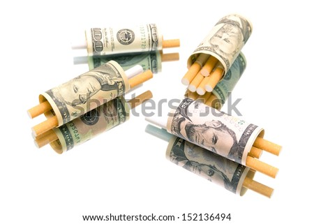 money and cigarettes on a white background. expensive habit. horizontal photo - top view - stock photo