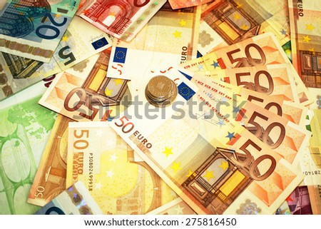 Money and coins all around - stock photo