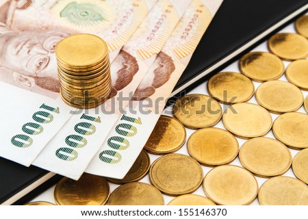 money and coins on book on book on book