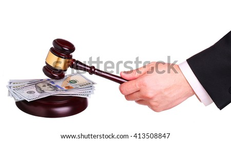 Money and gavel in hand isolated on white