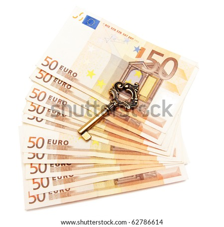 money and key isolated on white - stock photo