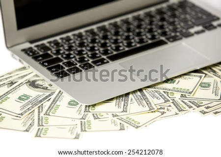 Money and laptop - stock photo