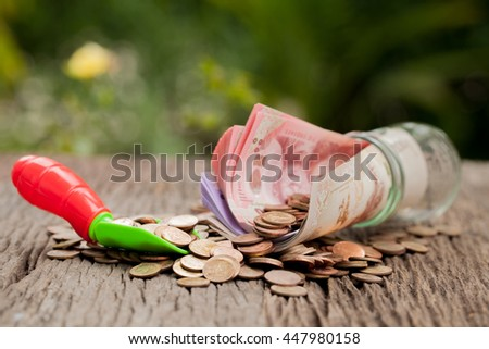 Money and money jar with shovel and banknote, Saving money concept, Growth, business, money. - stock photo