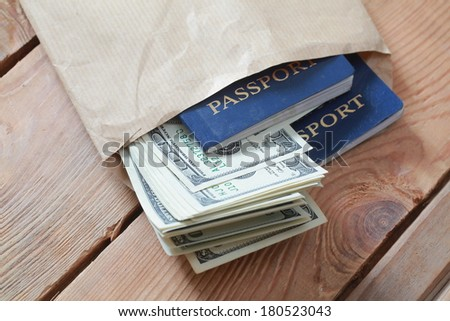 money and passport in an envelope