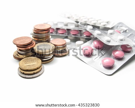 Money and pills on white background,for health care,medicine,money themes - stock photo