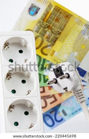 Money and power socket - stock photo