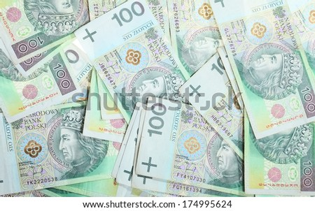 Money and savings concept. 100 polish zloty banknotes currency as background