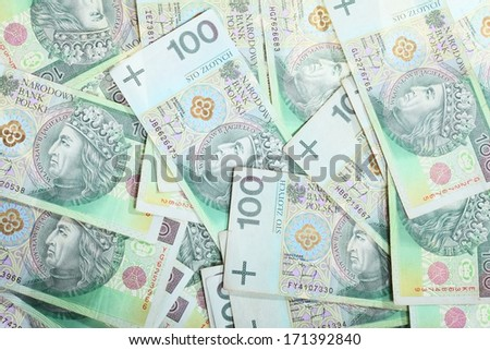 Money and savings concept. 100's polish zloty banknotes currency as background