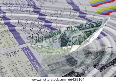 Money and stock quotes - Concept with paper dollar boat - stock photo
