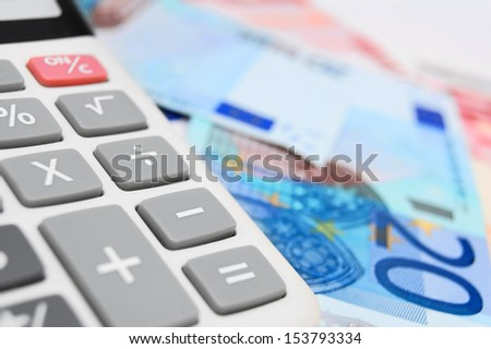 Money and the calculator. - stock photo
