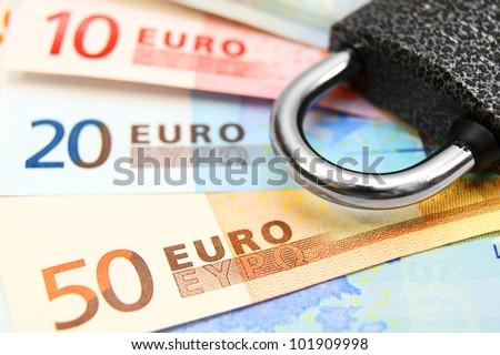 Money and the lock. - stock photo