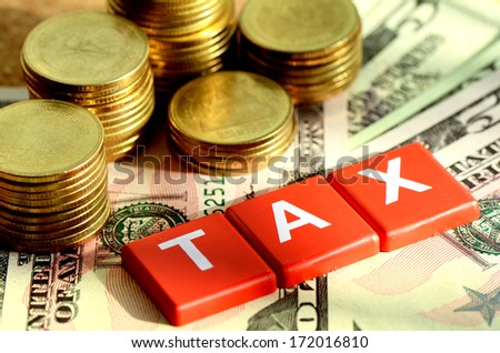 Money and time for any kind of taxes payment concept with dollars bank note background. - stock photo