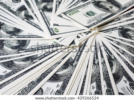 Money as background. One hundred dollars heap. Selective focus. - stock photo