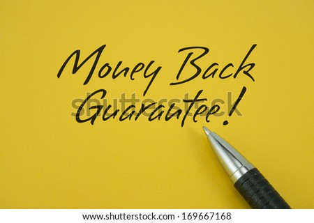 Money Back Guarantee note with pen on yellow background