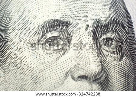 Money background - American dollars. Eyes of Benjamin Franklin - stock photo