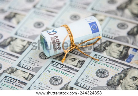 Money background - euro and dollars currency - stock photo