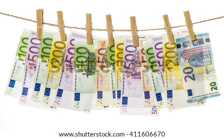 Money background. Euro banknotes hanging a rope with clothes pins - stock photo