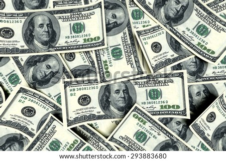 Money background from curled dollars usa. Business concept