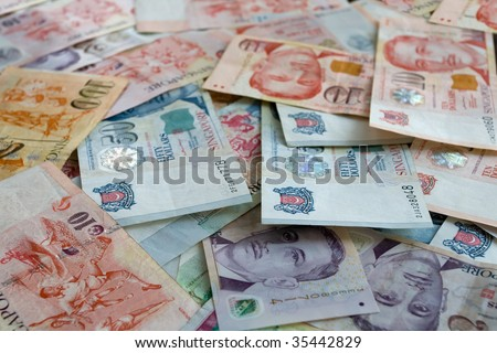 Money background from Various nominal Singapore dollars - stock photo