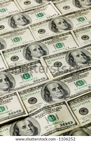 Money background pattern of one hundred dollar bills.