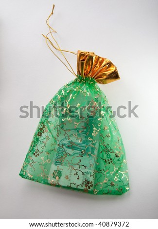 Money Bag of green color with roubles - stock photo