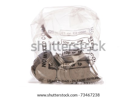 Money bag of sterling ten pence coins studio cutout - stock photo