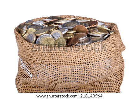 Money bag with coins isolated at a white background, isolated over white - stock photo