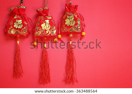 Money bags of the Chinese New Year on red Background. meaning prosperity and wealth