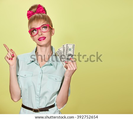 Money, banking finance and success concept. Business woman with dollar bill, cash thinking idea. Attractive happy confidence blonde in stylish glasses. Unusual playful, emotion. Blue eyes. Copy space - stock photo