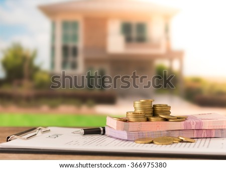 Money, banknote on mortgage loans document or loan contract credit for housing with real estate property background.   - stock photo